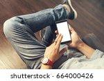 man in bluejeans wearing a red... | Shutterstock . vector #664000426