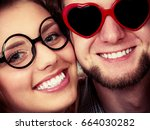 happy young couple in heart... | Shutterstock . vector #664030282