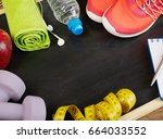 fitness equipment on blackboard | Shutterstock . vector #664033552