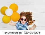cute girl embracing her friend... | Shutterstock . vector #664034275