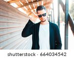 stylish young business man in... | Shutterstock . vector #664034542