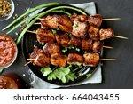 pork kebabs  bbq meat on plate  ...   Shutterstock . vector #664043455