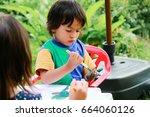 happy kids painting .activity... | Shutterstock . vector #664060126