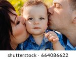Parents Kiss Pretty Little Boy