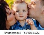 Parents Kiss Pretty Little Boy