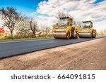 Two Working Road Rollers Makin...