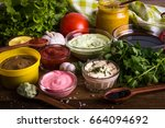 different sauces on a wooden... | Shutterstock . vector #664094692
