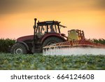 Tractor spraying pesticides on...