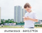 child boy playing mobile games... | Shutterstock . vector #664127926