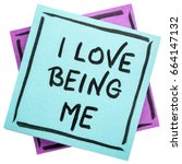 Small photo of I love being me - positive affirmation - handwriting on an isolated sticky note