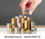 human hand putting coin to... | Shutterstock . vector #664150672