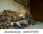 a boy carrying logs | Shutterstock . vector #664157692