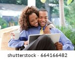 young couple with laptop | Shutterstock . vector #664166482