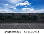empty parking lot and old gray... | Shutterstock . vector #664180915