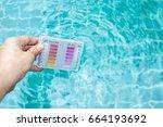 girl hand holding water testing ...   Shutterstock . vector #664193692