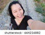 selfie thai woman  self portrait | Shutterstock . vector #664216882