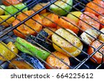 on the grid grill are fried... | Shutterstock . vector #664225612
