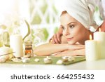 girl lying down on a massage bed | Shutterstock . vector #664255432