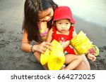 baby sister getting help by her ... | Shutterstock . vector #664272025