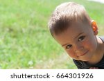 happy little boy in nature.... | Shutterstock . vector #664301926