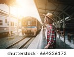 pretty woman waiting the train... | Shutterstock . vector #664326172