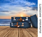 three travel cases over a... | Shutterstock . vector #664336072