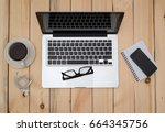 office wood table with notepad... | Shutterstock . vector #664345756