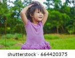 sweet little girl in purple... | Shutterstock . vector #664420375