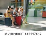 company of young tourists in... | Shutterstock . vector #664447642