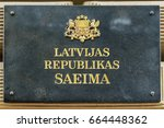 Small photo of A sign on the building and the parliament of Latvia in Latvian: Seim of the Republic of Latvia
