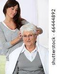 young woman doing an haircut to ... | Shutterstock . vector #66444892