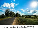 beautiful road at sunset.... | Shutterstock . vector #664457092
