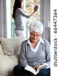 elderly woman reading book... | Shutterstock . vector #66447364