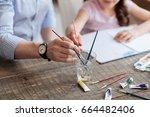 hands of daughter and her... | Shutterstock . vector #664482406