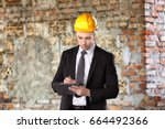 Small photo of Insurance adjuster in abandoned building