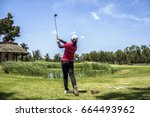 young woman practices her golf... | Shutterstock . vector #664493962