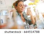 trendy girl using smartphone... | Shutterstock . vector #664514788