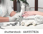 closeup finger nail care by... | Shutterstock . vector #664557826