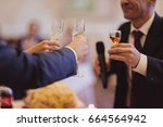 toast at the wedding  | Shutterstock . vector #664564942