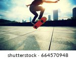 Young Woman Skateboarder...
