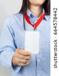 Small photo of Woman holding Identification white blank plastic id card.