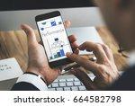 man working on digital device... | Shutterstock . vector #664582798