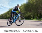Sporty Cyclist Riding Bicycle...