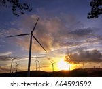 wind turbine farm at sunset... | Shutterstock . vector #664593592
