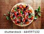 pizza with cherry tomatoes and... | Shutterstock . vector #664597132