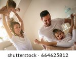 cheerful family playing... | Shutterstock . vector #664625812