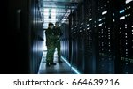 in data center two military men ... | Shutterstock . vector #664639216