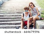 two young tourists relaxing and ... | Shutterstock . vector #664679596