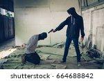 a terrorist man in hood holding ...   Shutterstock . vector #664688842