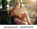 young teenage girl traveling... | Shutterstock . vector #664693342